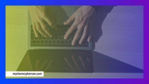 hand on laptop keyboard