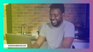 man typing on laptop in kitchen